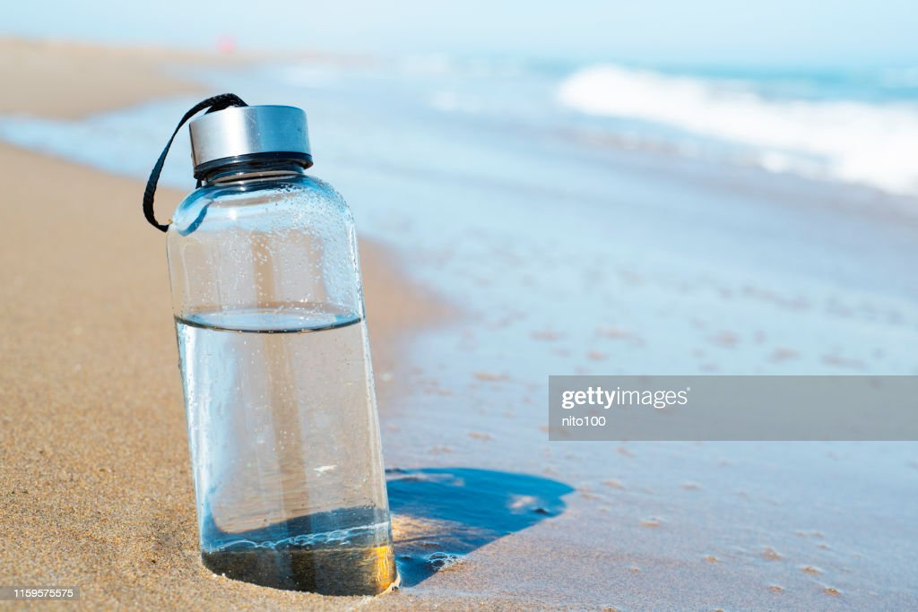 reusable water bottle on the beach : Stock Photo