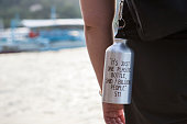 Reusable water bottle with text