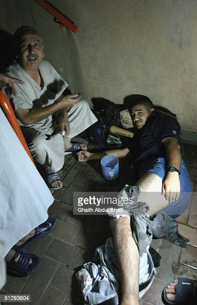 Reuters camera man lies injured in the basement of a building in Haifa Street on September 12 2004 in Baghdad Iraq Fighting broke out in the early...