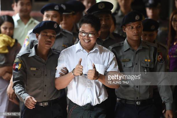 Reuters journalist Wa Lone arrives in court in Yangon on September 3 2018 to face verdict after months of trial since he was detained on December 12...