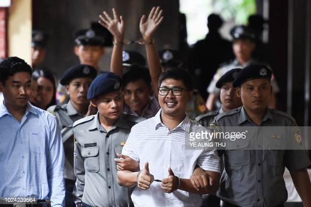TOPSHOT Reuters journalist Wa Lone followed by Kyaw Soe Oo arrive in court in Yangon on August 27 2018 to face verdict after months of trial since...