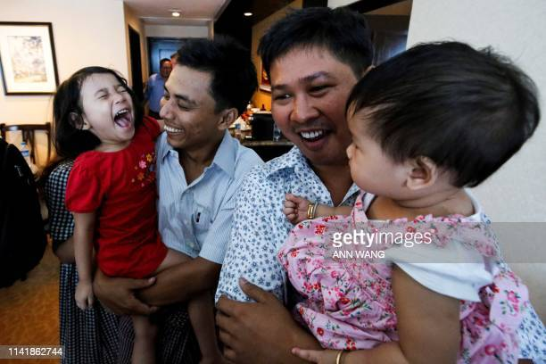 Reuters journalists Wa Lone and Kyaw Soe Oo celebrate with their children after being freed freed from Insein prison after a presidential amnesty in...