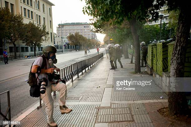 Reuters photographer Yannis Behrakis gets caught under a shock bomb during a protest in Thessaloniki Greece Sept 11 2011 Taxi cab drivers students...