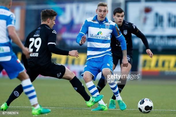 Reuven Niemeijer of Heracles Almelo Nicolai BrockMadsen of PEC Zwolle Justin Hoogma of Heracles Almeloduring the Dutch Eredivisie match between PEC...