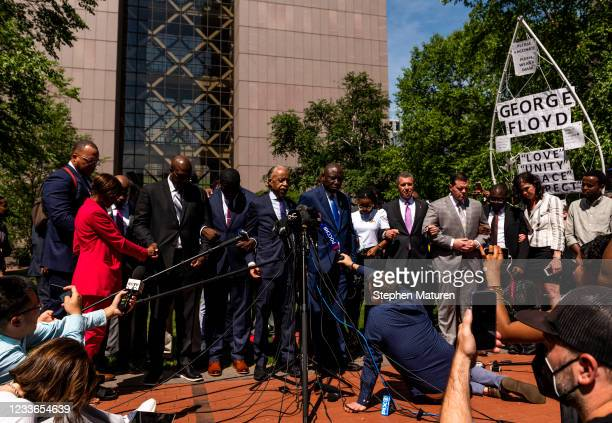Rev. Al Shaprton leads a prayer outside the Hennepin County Government Center after the sentencing of Derek Chauvin on June 25, 2021 in Minneapolis,...