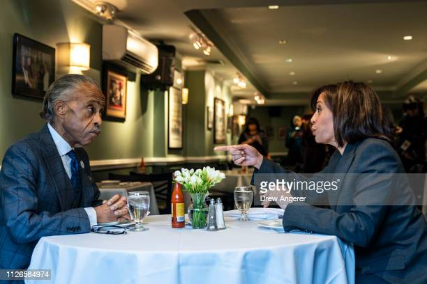 Rev Al Sharpton and 2020 Democratic presidential candidate Sen Kamala Harris talk while having lunch at Sylvia's Restaurant in Harlem February 21...
