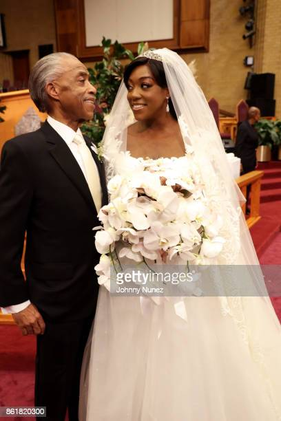 Rev. Al Sharpton and Dominique Sharpton pose during Dominique Sharpton And Dr. Marcus Bright's wedding ceremony on October 15, 2017 in New York City.