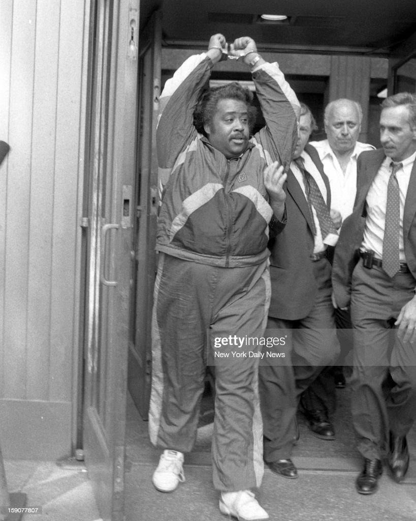 Rev. Al Sharpton arrested as he leaves court at 100 Centre St. handcuffed. Sharpton, the flamboyant minister often arrested in social protests, was in handcuffs again. This time on criminal charges of state tax evasion, scheming to defraud and grand larceny. Sharpton is charged in a 67-count indictment with stealing more than $250,000 from the National Youth Movement, an organization he headed, and falsifying business records to cover up the scheme. The indictment is the result of a two-year investigation by state Attorney General Robert Abrams, who clashed with Sharpton when Abrams investigated the Tawana Brawley case. Eight detectives arrested Sharpton about 1 p.m. at his Brooklyn home. He was taken to Manhattan Criminal Court for arraignment. Sharpton, 34, dressed in a black nylon jumpsuit that has become a personal trademark, gave a majestic bow to the courtroom. When asked to enter a plea, Sharpton declared in a loud voice: 'I think the attorney general is insane.' Abrams said that among the victims of Sharpton's phony fund-raising were Donald Trump, boxing promoter Don King and CBS Inc. All bought tables at a 1987 dinner that was supposed to benefit Daytop Village, a drug rehabilitation program. Abrams said that Daytop received only $6,000 of $75,000 raised by Sharpton.
