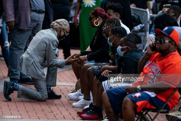 Rev. Al Sharpton greets Bridgette Floyd, the sister of the late George Floyd during the inaugural remembrance rally and march hosted by the George...