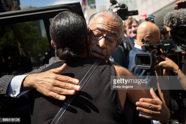 Rev Al Sharpton hugs Ellisha Garner following a press conference after meeting with Department of Justice officials June 21 2017 in the Brooklyn...