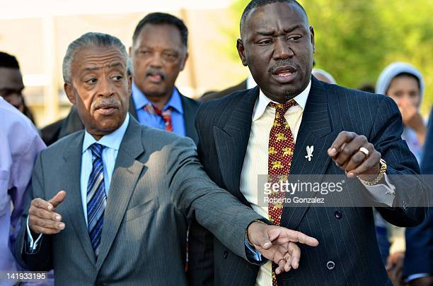 Rev Al Sharpton Jessie Jackson and Benjamin Crump attorney for the Trayvon Martin family join together in a protest march just prior to a town hall...