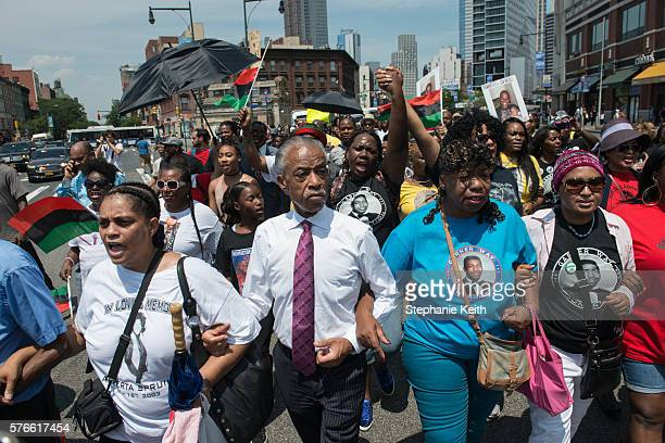 Rev Al Sharpton leads a march commemorating the two year anniversary of Eric Garner's death with Gwen Carr Eric Garner's mother on July 16 2016 in...