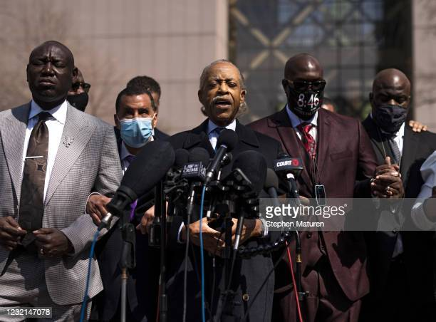 Rev. Al Sharpton leads a prayer as he's joined by members of George Floyd's family and attorney Ben Crump outside the Hennepin County Government...