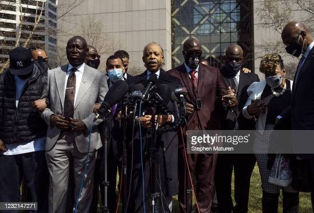 Rev. Al Sharpton leads a prayer as he's joined by members of George Floyd's family outside the Hennepin County Government Center on April 6, 2021 in...