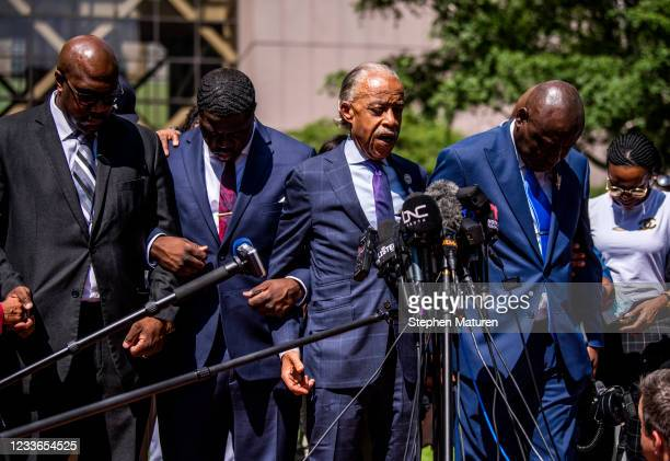 Rev. Al Sharpton leads the family of George Floyd in prayer outside the Hennepin County Government Center after the sentencing of Derek Chauvin on...