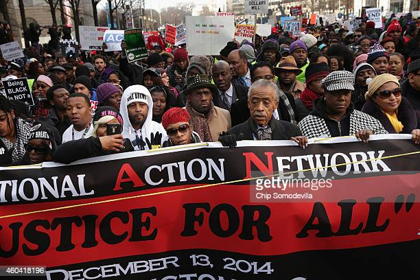 Rev Al Sharpton leads the Justice For All march in the nation's capital with the families of Eric Garner Michael Brown Tamir Rice Trayvon Martin and...