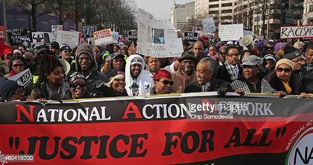 Rev Al Sharpton leads the Justice For All march in the nation's capital with the families of Eric Garner Michael Brown Tamir Rice Trayvon Martin...