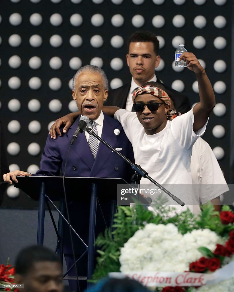 Rev. Al Sharpton, left, speaks to Stevante Clark during the funeral services for police shooting victim Stephon Clark at Bayside Of South Sacramento Church March 29, 2018 in Sacramento, California. Clark, who was unarmed, was shot and killed by Sacramento Police Officers, Sunday, March 18, 2018.