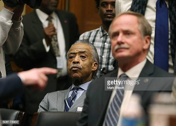 Rev Al Sharpton sits behind Keith Creagh director of Michigan's Department of Environmental Quality during a House Oversight and Government Reform...