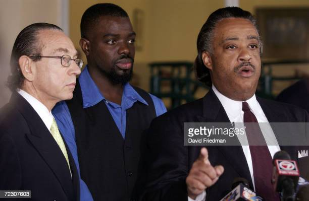 Rev Al Sharpton speaks as Abner Louima and Louimas attorney Sanford Rubenstein stand nearby March 7 2002 during a press conference at the Roney...