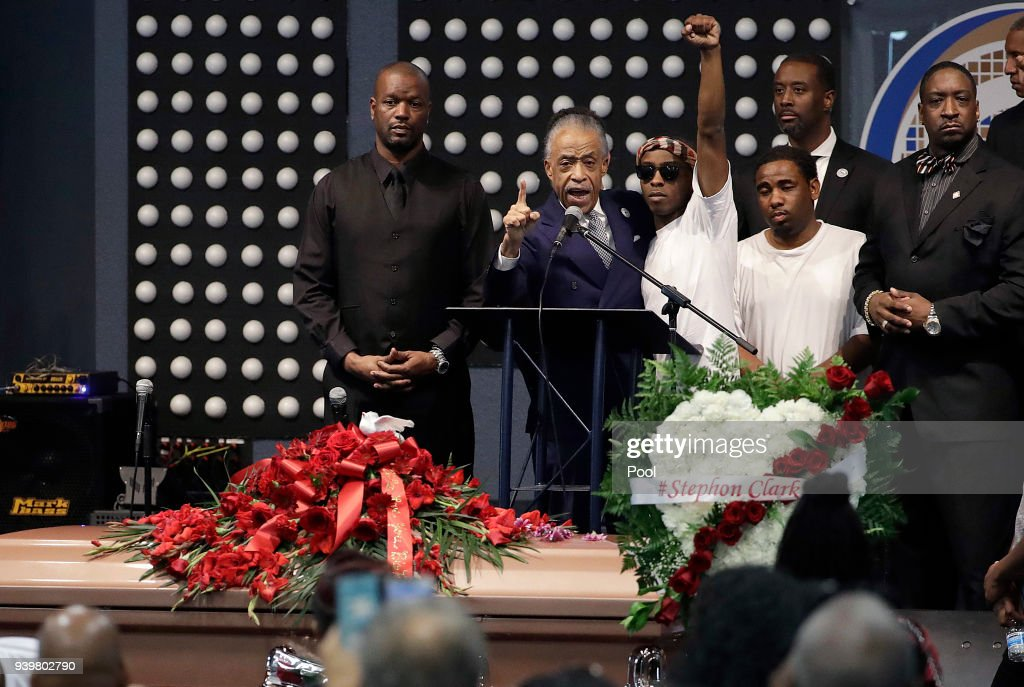 Rev. Al Sharpton (2L) speaks to Stevante Clark (arm raised) during the funeral services for police shooting victim Stephon Clark at Bayside Of South Sacramento Church March 29, 2018 in Sacramento, California. Clark, who was unarmed, was shot and killed by Sacramento Police Officers, Sunday, March 18, 2018.