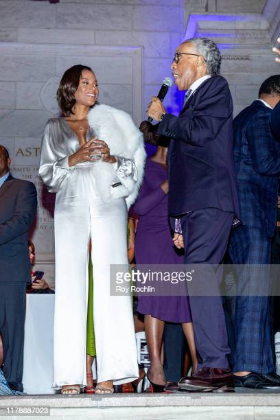 Rev Al Sharpton with Aisha McShaw on stage during his 65th Birthday Celebration at New York Public Library Stephen A Schwartzman Building on October...
