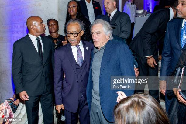 Rev Al Sharpton with Robert De Niro on stage at Rev Al Sharpton's 65th Birthday Celebration at New York Public Library Stephen A Schwartzman Building...