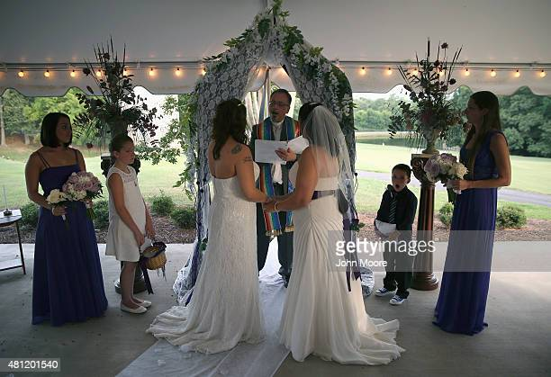 Rev. Andy Sidden marries Melissa Adams , and Meagan Martin during their wedding ceremony at a golf club on July 11, 2015 in Lexington, South...