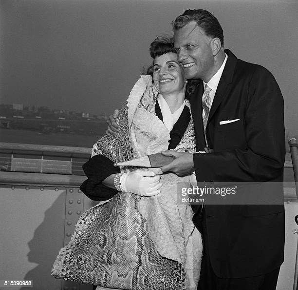 Rev Billy Graham gets an affectionate welcome from his wife Ruth on arrival aboard the liner Queen Elizabeth Graham was returning from a 2 1/2 month...