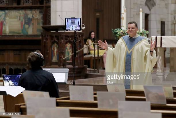 Rev Brian X Needles delivers Easter Sunday Mass as Gabriel Baseman runs livestream on April 12 2020 at Our Lady of Sorrows Catholic Church in South...