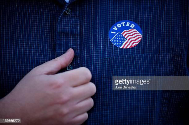 Rev Chase Peeples proudly displays his I Voted sticker at the Country Club Congregational Church on November 6 2012 in Kansas City Missouri Rev Chase...