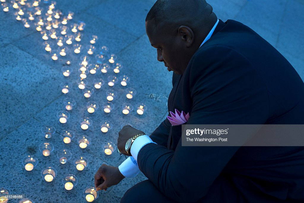 A candle light vigil memorializing the death of voting rights activists in Mississippi. : News Photo