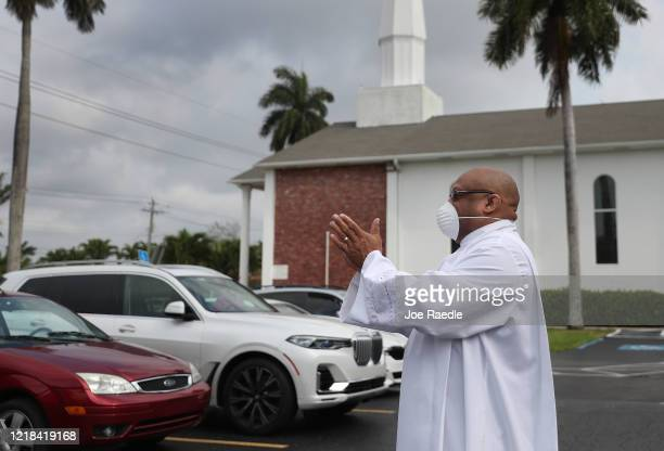 Rev Dr Robert Griffin greets parishioners as they arrive for an Easter service in the parking lot of the Sunshine Cathedral on April 12 2020 in Fort...