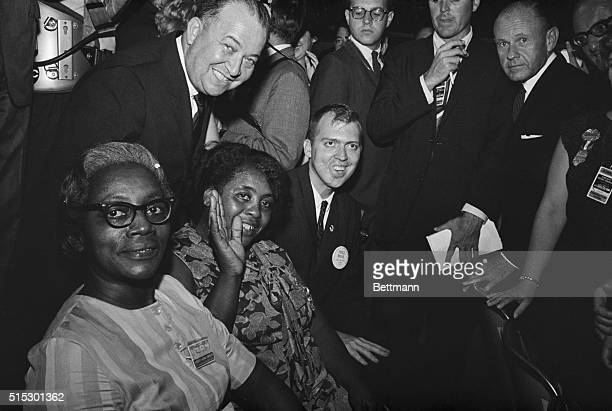 Rev Edwin King Fannie Lou Hamer and Annie Devine cofounders of the Mississippi Freedom Democratic Party are seated with the Michigan Delegation at...