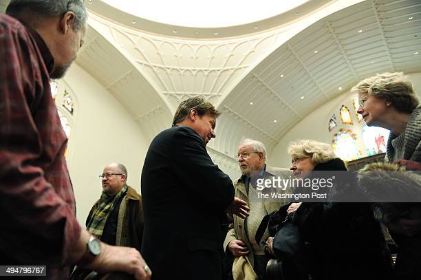 Rev Frank Schaefer center speaks with Suzanne Forsyth second from right at Foundry United Methodist Church on Sunday January 26 2014 in Washington DC...