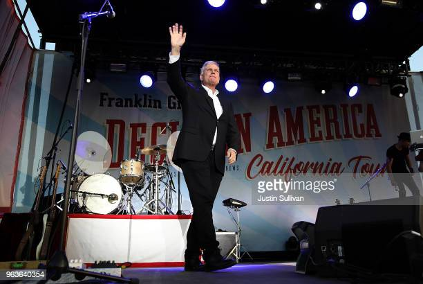 Rev Franklin Graham waves to attendees during Franklin Graham's 'Decision America' California tour at the Stanislaus County Fairgrounds on May 29...