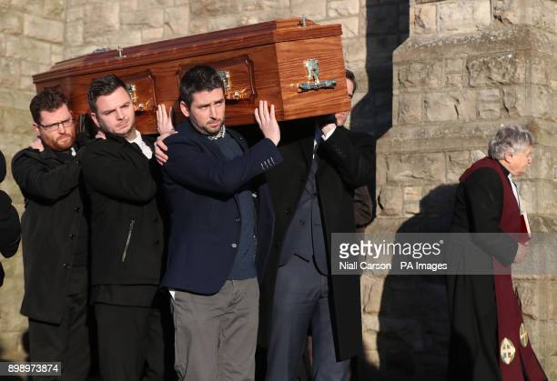 Rev Harold Good walks in front of Dr Maurice Hayes coffin as its carried from St Patrick's Church Downpatrick Co Down following his death aged 90 two...