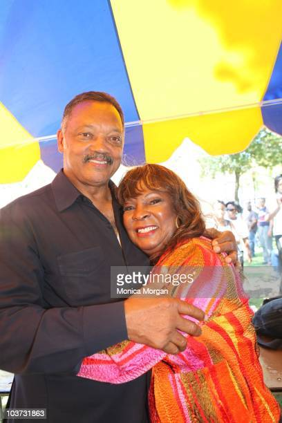 Rev Jesse Jackson and Martha Reeves participate in a 'Rebuild AmericaJobs Justice and Peace' march at UAWFord National Programs Center on August 28...