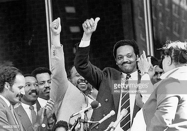Rev Jesse Jackson Baptist minister and civil rights leader acknowledges cheers from the crowds gathered at downtown Hopkins Plaza and gives a thumbs...