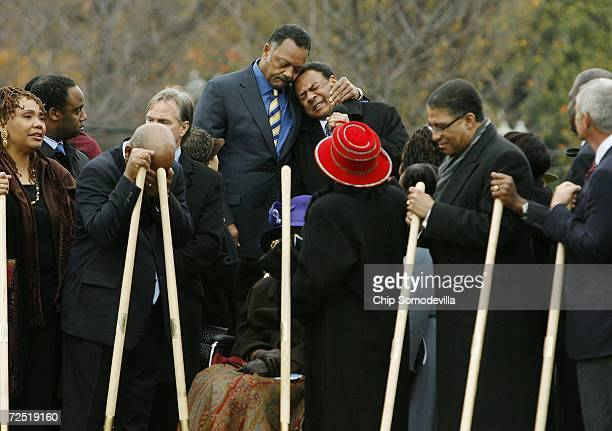 Rev Jesse Jackson comforts Ambassador Andrew Young as Young gives an invocation at the groundbreaking of the Martin Luther King Jr National Memorial...