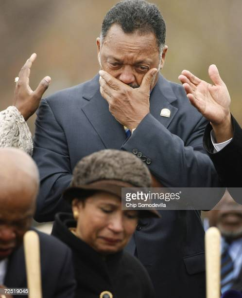 Rev Jesse Jackson covers his face while weeping during an invocation at the groundbreaking of the Martin Luther King Jr National Memorial November 13...