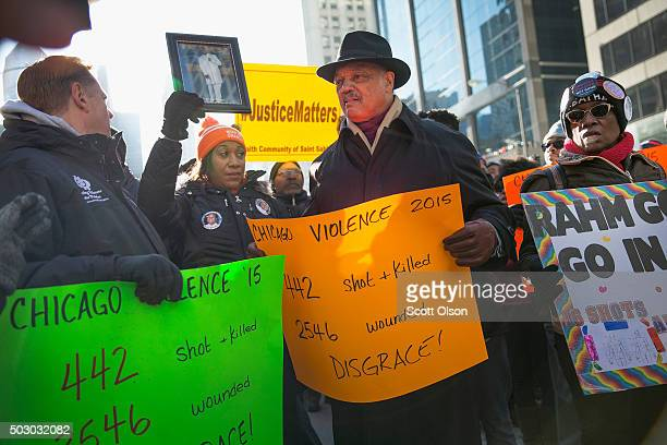 Rev Jesse Jackson helps to lead demonstrators calling for an end to gun violence and the resignation of Chicago Mayor Rahm Emanuel as they march...