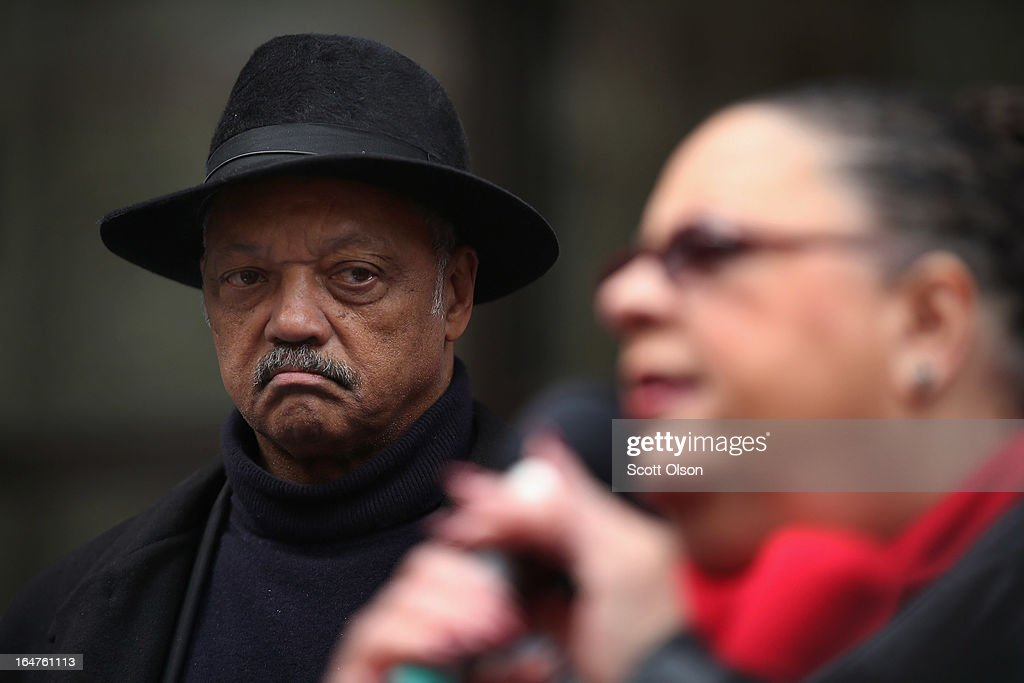 Rev. Jesse Jackson (L) listens as Chicago Teachers Union President Karen Lewis speaks to demonstrators protesting school closings on March 27, 2013 in Chicago, Illinois. About 2,000 protestors held a rally and marched through downtown to protest a plan by the city to close more than 50 elementary schools, claiming it is necessary to rein in a looming $1 billion budget deficit. The closings would shift about 30,000 students to new schools and leave more than 1,000 teachers with uncertain futures.