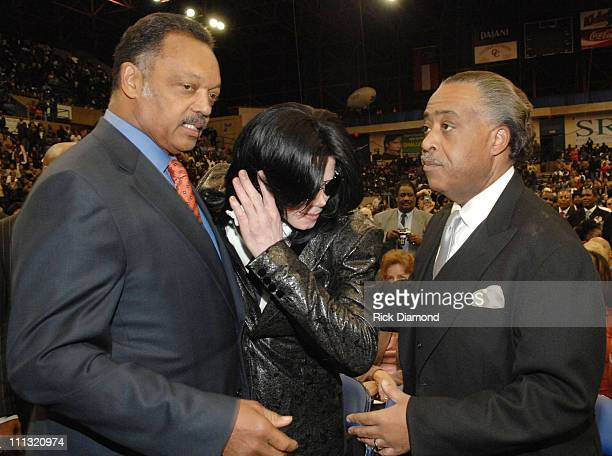 Rev Jesse Jackson Michael Jackson and Rev Al Sharpton pay their respects to the late James Brown who is lying in repose at the James Brown Arena in...