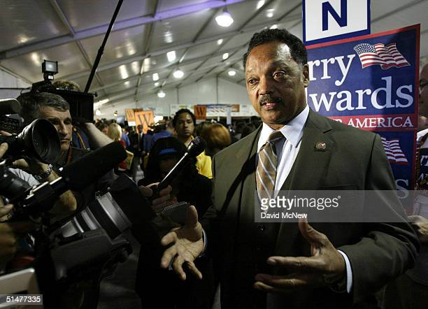 """Rev Jesse Jackson speaks to reporters on """"Spin Alley"""" following the presidential debate between U.S. President George W. Bush and Democratic..."""