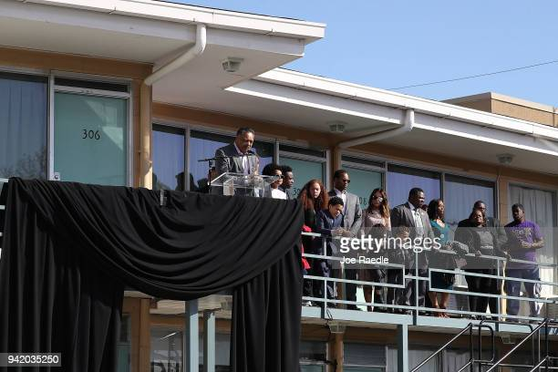 Rev Jesse Jackson Sr speaks as his family stands near him from the balcony outside room 306 at the Lorraine Motel where he was when Dr Martin Luther...