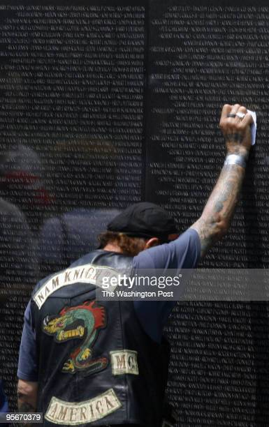 Rev Jim Warren with the Nam Knights touches name on the Vietnam Wall of his high school friend Stanley Reed who died at 19 years old He rode in with...