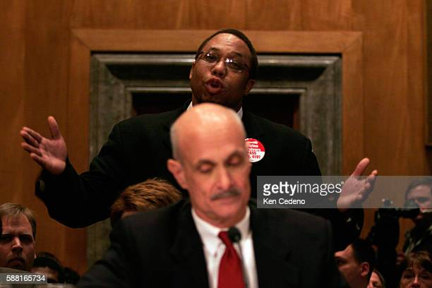 Rev Lennox Yearwood Jr President and CEO of Hip Hop Caucus stands and objects during hearing beofore the Homeland Security and Governmental Affairs...