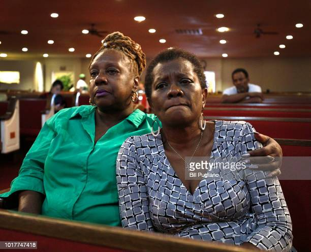 Rev Leslie Mathews and Emma Lockridge both of Detroit Michigan sit and mourn the death of singer Aretha Franklin at New Bethel Baptist Church where...