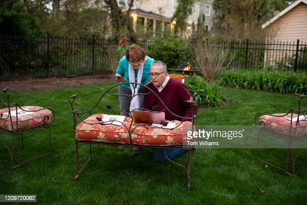 Rev Maggie Hayward of the Northwood Presbyterian Church prepares to conduct a virtual sunrise worship on Easter morning as her husband Rev Larry...